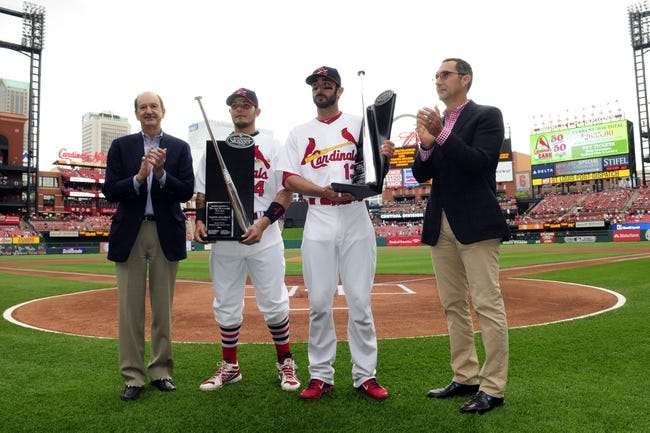 Apr 27, 2014; St. Louis, MO, USA; St. Louis Cardinals catcher Yadier Molina (4) and third baseman Matt Carpenter (13) receive their silver slugger awards from Bill Dewitt Jr (left) and John Mozeliak (right) before a game against the Pittsburgh Pirates at Busch Stadium. Mandatory Credit: Jeff Curry-USA TODAY Sports
