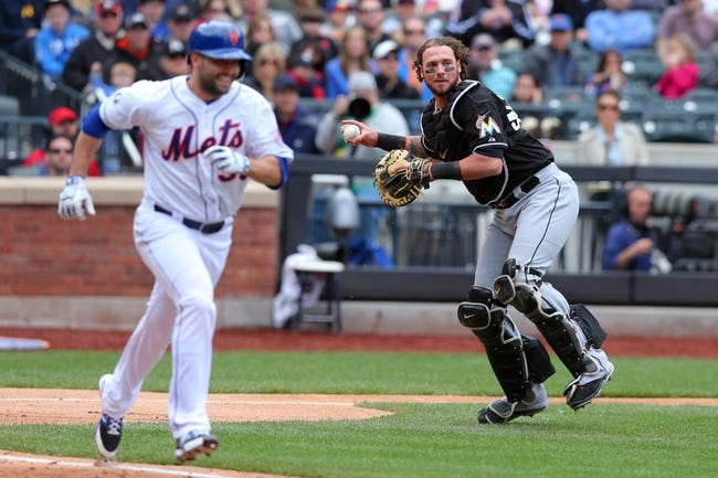 Apr 27, 2014; New York, NY, USA; Miami Marlins catcher Jarrod Saltalamacchia (39) throws out New York Mets starting pitcher Dillon Gee (35) on a sacrifice bunt during the fourth inning of a game at Citi Field. Mandatory Credit: Brad Penner-USA TODAY Sports