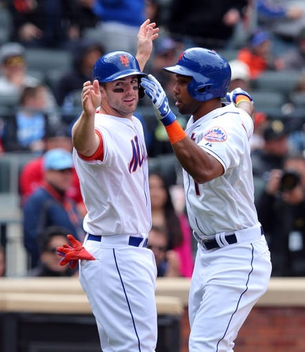 Apr 27, 2014; New York, NY, USA; New York Mets left fielder Chris Young (1) is congratulated at home by New York Mets third baseman David Wright (5) after hitting a two-run home run against the Miami Marlins during the fifth inning of a game at Citi Field. Mandatory Credit: Brad Penner-USA TODAY Sports