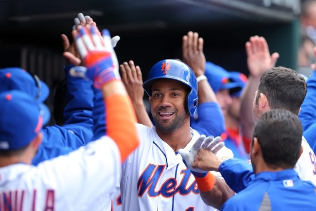 Apr 27, 2014; New York, NY, USA; New York Mets left fielder Chris Young (1) is congratulated in the dugout after hitting a two-run home run against the Miami Marlins during the fifth inning of a game at Citi Field. Mandatory Credit: Brad Penner-USA TODAY Sports