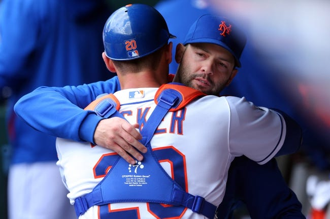Apr 27, 2014; New York, NY, USA; New York Mets starting pitcher Dillon Gee (35) hugs New York Mets catcher Anthony Recker (20) after defeating the Miami Marlins in a game at Citi Field. Mandatory Credit: Brad Penner-USA TODAY Sports