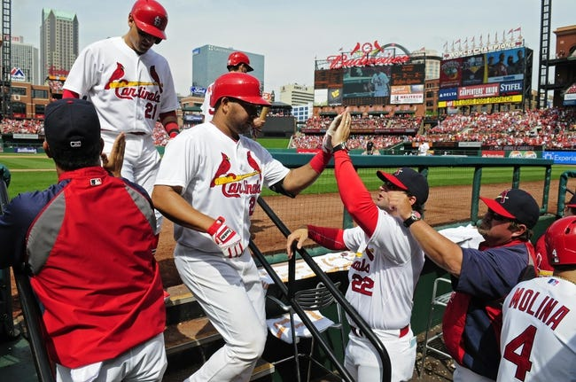 Apr 27, 2014; St. Louis, MO, USA; St. Louis Cardinals shortstop Jhonny Peralta (27) is congratulated by manager Mike Matheny (22) after he hit a three run home run off of Pittsburgh Pirates starting pitcher Edinson Volquez (not pictured) during the sixth inning at Busch Stadium. Mandatory Credit: Jeff Curry-USA TODAY Sports