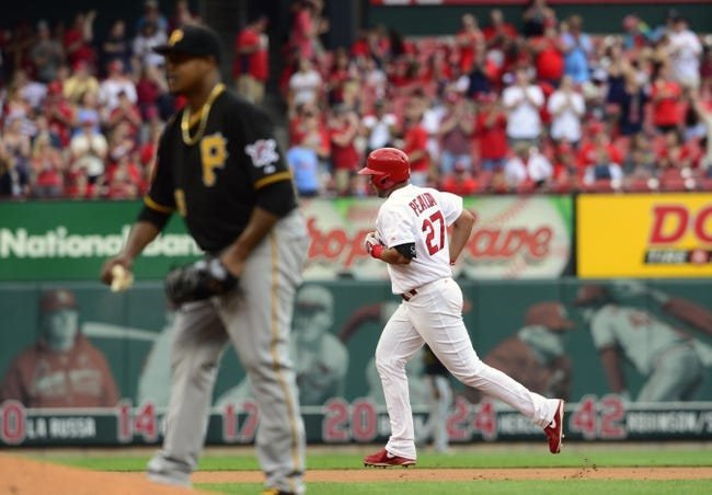 Apr 27, 2014; St. Louis, MO, USA; St. Louis Cardinals shortstop Jhonny Peralta (27) runs the bases after hitting a solo home run off of Pittsburgh Pirates starting pitcher Edinson Volquez (36) during the fifth inning at Busch Stadium. Mandatory Credit: Jeff Curry-USA TODAY Sports