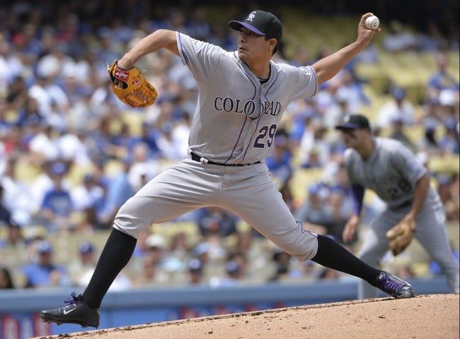 Apr 27, 2014; Los Angeles, CA, USA; Colorado Rockies starting pitcher Jorge De La Rosa (29) throws in the first inning against the Los Angeles Dodgers at Dodger Stadium. Mandatory Credit: Robert Hanashiro-USA TODAY Sports