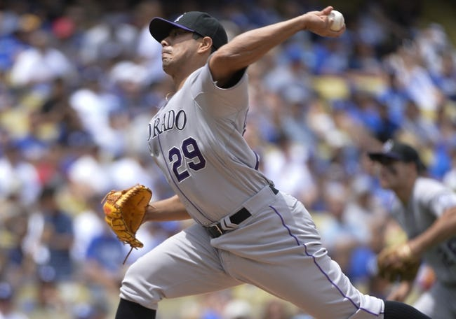 Apr 27, 2014; Los Angeles, CA, USA; Colorado Rockies starting pitcher Jorge De La Rosa (29) throws in the second inning against the Los Angeles Dodgers at Dodger Stadium. Mandatory Credit: Robert Hanashiro-USA TODAY Sports