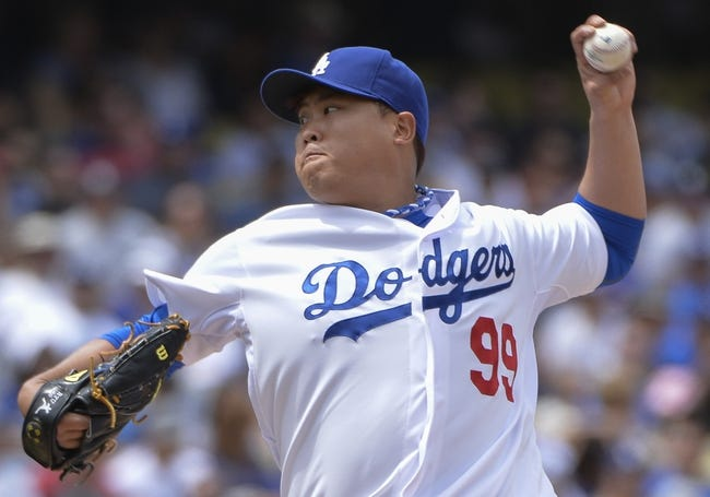Apr 27, 2014; Los Angeles, CA, USA; Los Angeles Dodgers starting pitcher Hyun-Jin Ryu (99) throws against the Colorado Rockies in the second inning at Dodger Stadium. Mandatory Credit: Robert Hanashiro-USA TODAY Sports