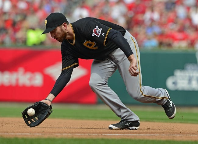 Apr 27, 2014; St. Louis, MO, USA; Pittsburgh Pirates first baseman Ike Davis (15) fields a ground ball hit by St. Louis Cardinals shortstop Daniel Descalso (33) during the sixth inning at Busch Stadium. St. Louis defeated Pittsburgh 7-0. Mandatory Credit: Jeff Curry-USA TODAY Sports