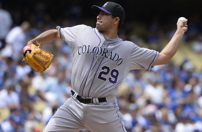 Apr 27, 2014; Los Angeles, CA, USA; Colorado Rockies starting pitcher Jorge De La Rosa (29) throws in the third inning against the Los Angeles Dodgers at Dodger Stadium. Mandatory Credit: Robert Hanashiro-USA TODAY Sports