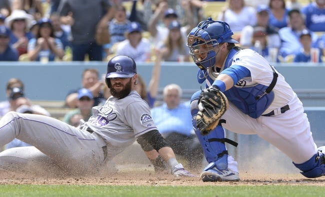 Apr 27, 2014; Los Angeles, CA, USA; Colorado Rockies center fielder Charlie Blackmon (19) slides into home to score beating a throw to Los Angeles Dodgers catcher Tim Federowicz (26) in the 5th inning at Dodger Stadium. Mandatory Credit: Robert Hanashiro-USA TODAY Sports