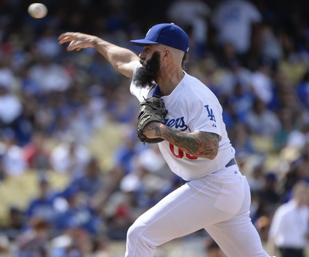 Apr 27, 2014; Los Angeles, CA, USA; Dodger relief pitcher Brian Wilson throws in the seventh inning against the Colorado Rockies at Dodger Stadium. Mandatory Credit: Robert Hanashiro-USA TODAY Sports