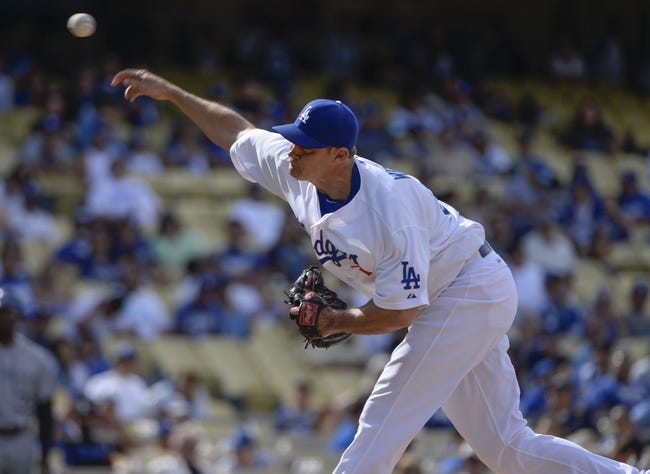 Apr 27, 2014; Los Angeles, CA, USA; Los Angeles Dodgers relief pitcher Jamey Wright (28) throws in the 9th inning against the Colorado Rockies at Dodger Stadium. Mandatory Credit: Robert Hanashiro-USA TODAY Sports