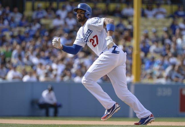 Apr 27, 2014; Los Angeles, CA, USA Los Angeles Dodgers center fielder Matt Kemp (27) on the base paths during the Dodgers 6-1 loss to the Colorado Rockies  at Dodger Stadium. Mandatory Credit: Robert Hanashiro-USA TODAY Sports