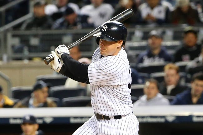 Apr 27, 2014; Bronx, NY, USA;  New York Yankees third baseman Kelly Johnson (33) singles to center during the third inning against the Los Angeles Angels at Yankee Stadium. Mandatory Credit: Anthony Gruppuso-USA TODAY Sports