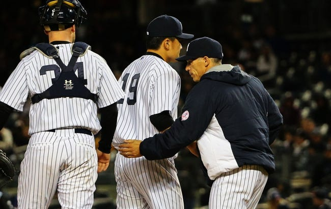 Apr 27, 2014; Bronx, NY, USA;  New York Yankees manager Joe Girardi (28) relieves starting pitcher Masahiro Tanaka (19) during the seventh inning against the Los Angeles Angels at Yankee Stadium. New York Yankees won 3-2.  Mandatory Credit: Anthony Gruppuso-USA TODAY Sports