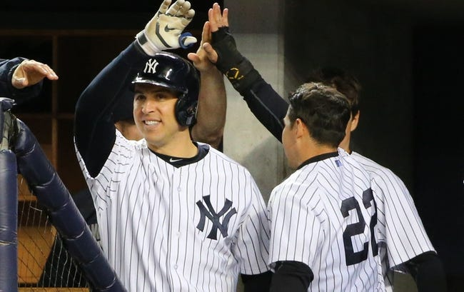 Apr 27, 2014; Bronx, NY, USA; New York Yankees center fielder Jacoby Ellsbury (22) celebrates scoring during the eighth inning against the Los Angeles Angels at Yankee Stadium. New York Yankees won 3-2.  Mandatory Credit: Anthony Gruppuso-USA TODAY Sports