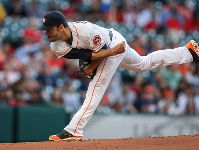 Apr 29, 2014; Houston, TX, USA; Houston Astros starting pitcher Jarred Cosart (48) delivers a pitch during the first inning against the Washington Nationals at Minute Maid Park. Mandatory Credit: Troy Taormina-USA TODAY Sports