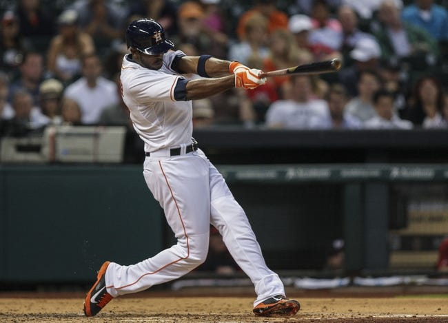 Apr 29, 2014; Houston, TX, USA; Houston Astros center fielder Dexter Fowler (21) drives in a run with a single during the third inning against the Washington Nationals at Minute Maid Park. Mandatory Credit: Troy Taormina-USA TODAY Sports