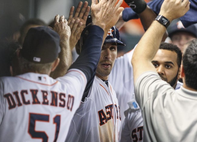 Apr 29, 2014; Houston, TX, USA; Houston Astros catcher Jason Castro (15) is congratulated after scoring a run during the third inning against the Washington Nationals at Minute Maid Park. Mandatory Credit: Troy Taormina-USA TODAY Sports