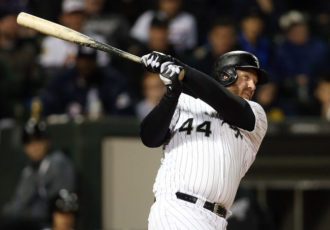 Apr 29, 2014; Chicago, IL, USA; Chicago White Sox designated hitter Adam Dunn (44) hits a RBI double against the Detroit Tigers in the third inning at U.S Cellular Field. Mandatory Credit: Jerry Lai-USA TODAY Sports
