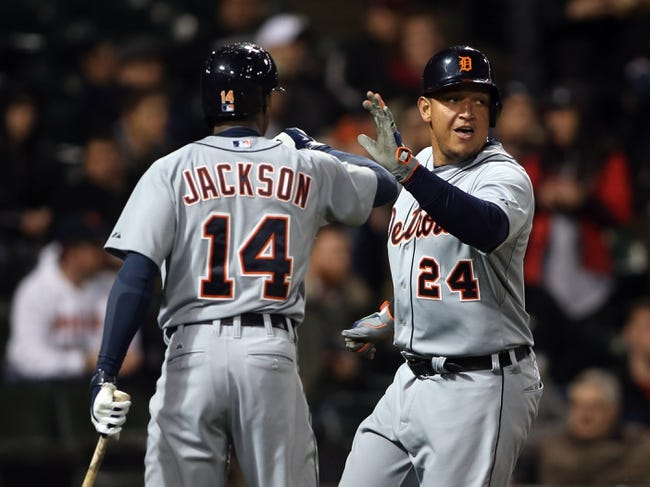 Apr 29, 2014; Chicago, IL, USA; Detroit Tigers first baseman Miguel Cabrera (24) celebrates with center fielder Austin Jackson (14) after scoring a run against the Chicago White Sox in the sixth inning at U.S Cellular Field. Mandatory Credit: Jerry Lai-USA TODAY Sports