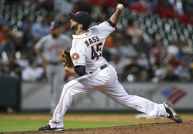 Apr 29, 2014; Houston, TX, USA; Houston Astros relief pitcher Anthony Bass (45) pitches during the seventh inning against the Washington Nationals at Minute Maid Park. Mandatory Credit: Troy Taormina-USA TODAY Sports