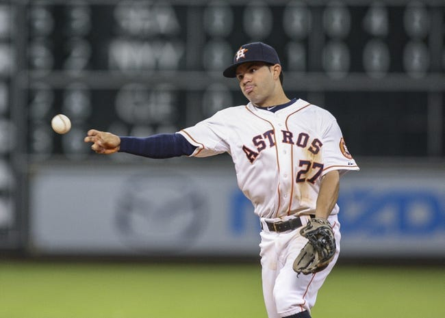 Apr 29, 2014; Houston, TX, USA; Houston Astros second baseman Jose Altuve (27) throws to first base during the seventh inning against the Washington Nationals at Minute Maid Park. Mandatory Credit: Troy Taormina-USA TODAY Sports