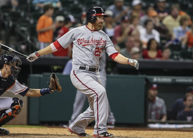 Apr 29, 2014; Houston, TX, USA; Washington Nationals first baseman Adam LaRoche (25) drives in a run with a single during the ninth inning against the Houston Astros at Minute Maid Park. Mandatory Credit: Troy Taormina-USA TODAY Sports