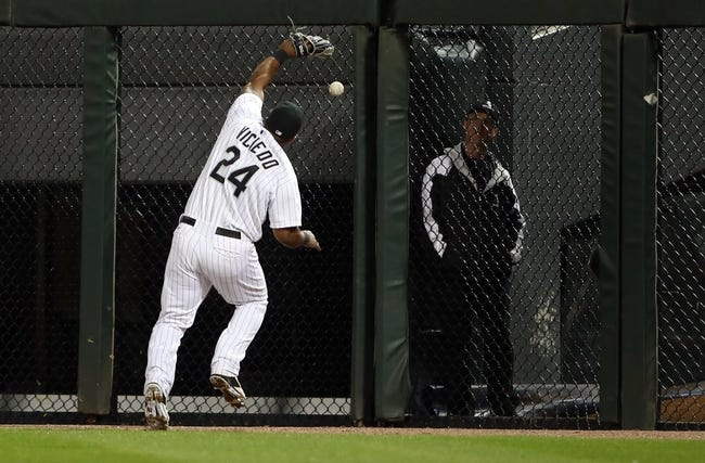 Apr 29, 2014; Chicago, IL, USA; Chicago White Sox right fielder Dayan Viciedo (24) commits a three-base error on a ball hit by Detroit Tigers center fielder Austin Jackson (not pictured) in the eighth inning at U.S Cellular Field. Mandatory Credit: Jerry Lai-USA TODAY Sports
