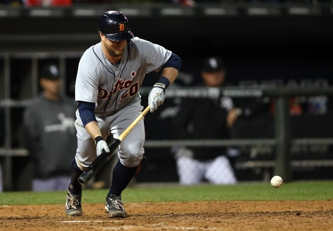 Apr 29, 2014; Chicago, IL, USA; Detroit Tigers catcher Bryan Holaday (50) drives in a run with a bun single against the Chicago White Sox in the eighth inning at U.S Cellular Field. Mandatory Credit: Jerry Lai-USA TODAY Sports