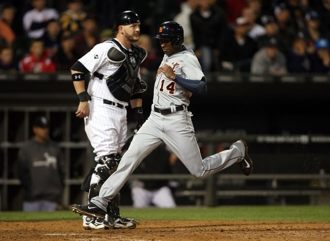 Apr 29, 2014; Chicago, IL, USA; Detroit Tigers center fielder Austin Jackson (14) scores a run past Chicago White Sox catcher Tyler Flowers (left) in the eighth inning at U.S Cellular Field. Mandatory Credit: Jerry Lai-USA TODAY Sports