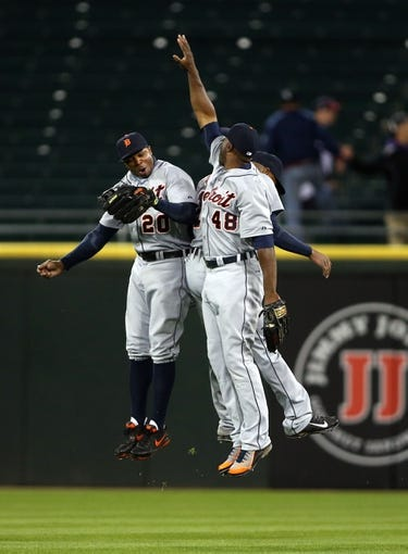 Apr 29, 2014; Chicago, IL, USA; Detroit Tigers outfielders Rajai Davis (20) , Torii Hunter (48) and Austin Jackson leap in celebration after defeating the Chicago White Sox 4-3 at U.S Cellular Field. Mandatory Credit: Jerry Lai-USA TODAY Sports
