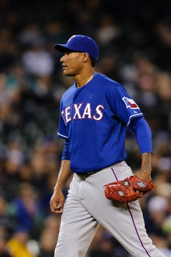 Apr 26, 2014; Seattle, WA, USA; Texas Rangers relief pitcher Alexi Ogando (41) during the game against the Seattle Mariners at Safeco Field. Texas defeated Seattle 6-3. Mandatory Credit: Steven Bisig-USA TODAY Sports