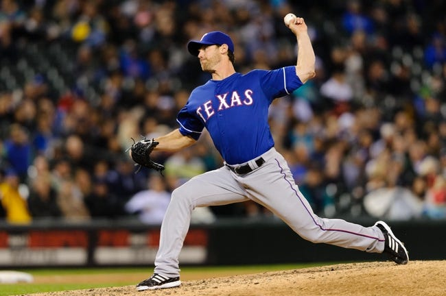 Apr 26, 2014; Seattle, WA, USA; Texas Rangers relief pitcher Neal Cotts (56) pitches to the Seattle Mariners during the game at Safeco Field. Texas defeated Seattle 6-3. Mandatory Credit: Steven Bisig-USA TODAY Sports