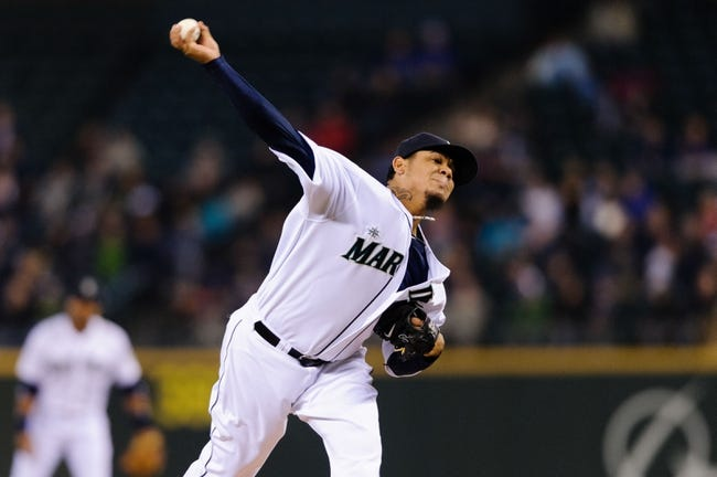 Apr 26, 2014; Seattle, WA, USA; Seattle Mariners starting pitcher Felix Hernandez (34) pitches to the Texas Rangers during the game at Safeco Field. Texas defeated Seattle 6-3. Mandatory Credit: Steven Bisig-USA TODAY Sports