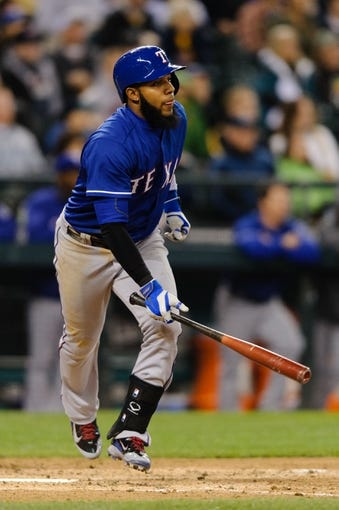 Apr 26, 2014; Seattle, WA, USA; Texas Rangers shortstop Elvis Andrus (1) runs towards first base after hitting the ball against the Seattle Mariners at Safeco Field. Texas defeated Seattle 6-3. Mandatory Credit: Steven Bisig-USA TODAY Sports