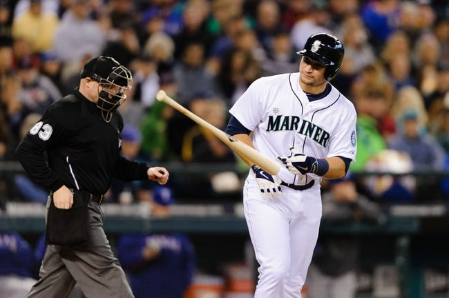 Apr 26, 2014; Seattle, WA, USA; Seattle Mariners catcher Mike Zunino (3) tosses the bat after being hit by a pitch during the game against the Texas Rangers at Safeco Field. Texas defeated Seattle 6-3. Mandatory Credit: Steven Bisig-USA TODAY Sports