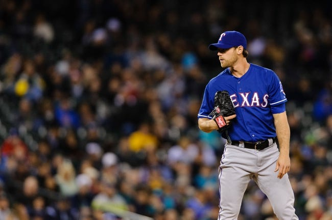 Apr 26, 2014; Seattle, WA, USA; Texas Rangers relief pitcher Neal Cotts (56) during the game against the Seattle Mariners at Safeco Field. Texas defeated Seattle 6-3. Mandatory Credit: Steven Bisig-USA TODAY Sports