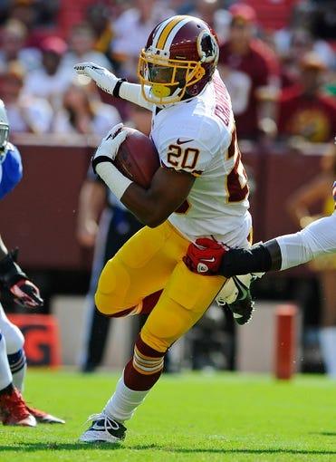 Aug 24, 2013; Landover, MD, USA; Washington Redskins cornerback Richard Crawford (20) returns a kick during the first half against the Buffalo Bills at FedEX Field. Mandatory Credit: Brad Mills-USA TODAY Sports