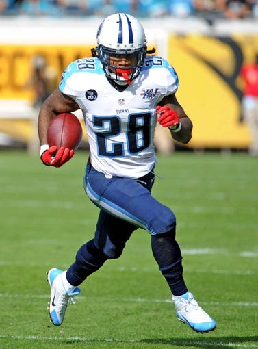 Dec 22, 2013; Jacksonville, FL, USA; Tennessee Titans running back Chris Johnson (28) runs the ball during the first half of the game against the Jacksonville Jaguars at EverBank Field. Mandatory Credit: Melina Vastola-USA TODAY Sports