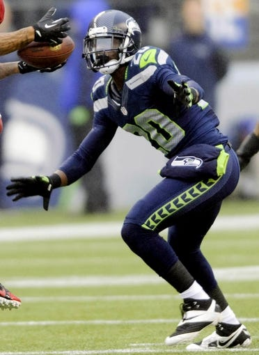 Dec 22, 2013; Seattle, WA, USA; Arizona Cardinals wide receiver catches a pass over Seattle Seahawks cornerback Jeremy Lane (20) during the first half at CenturyLink Field. Mandatory Credit: Steven Bisig-USA TODAY Sports