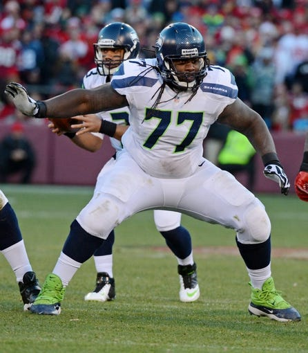 December 8, 2013; San Francisco, CA, USA; Seattle Seahawks guard James Carpenter (77) blocks during the fourth quarter against the San Francisco 49ers at Candlestick Park. The 49ers defeated the Seahawks 19-17. Mandatory Credit: Kyle Terada-USA TODAY Sports