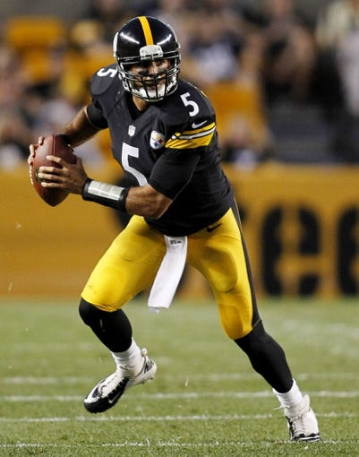 Aug 10, 2013; Pittsburgh, PA, USA; Pittsburgh Steelers quarterback Bruce Gradkowski (5) scrambles with the ball against the New York Giants during the second quarter at Heinz Field. The New York Giants won 18-13. Mandatory Credit: Charles LeClaire-USA TODAY Sports