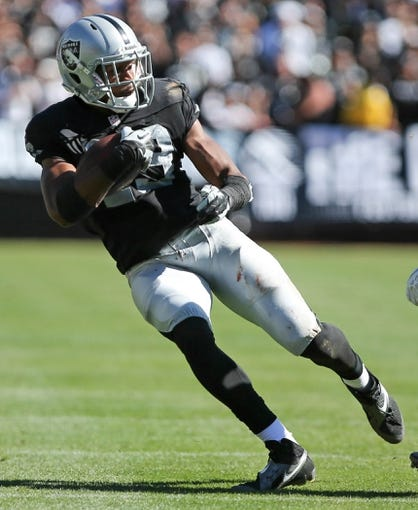Sep 15, 2013; Oakland, CA, USA; Oakland Raiders wide receiver Brice Butler (19) carries the ball against the Jacksonville Jaguars during the third quarter at O.co Coliseum. The Oakland Raiders defeated the Jacksonville Jaguars 19-9. Mandatory Credit: Kelley L Cox-USA TODAY Sports