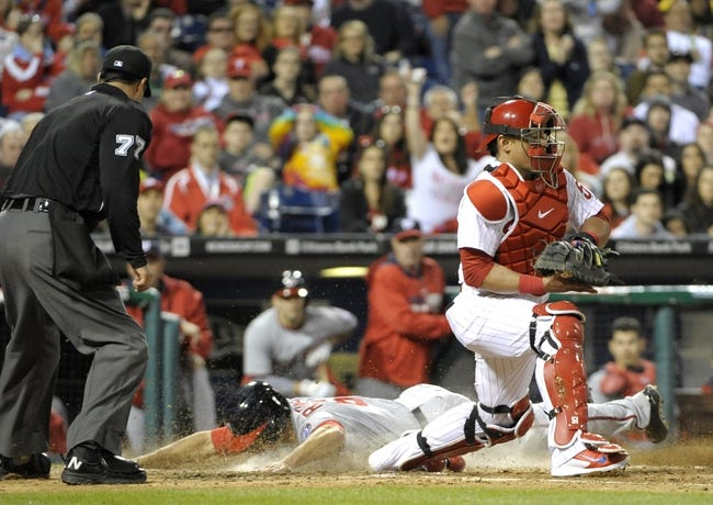 May 2, 2014; Philadelphia, PA, USA; Washington Nationals third baseman Anthony Rendon (6) slides safe;y into home ahead of tag by Philadelphia Phillies catcher Carlos Ruiz (51) in the eighth inning at Citizens Bank Park. The Nationals defeated the Phillies, 5-3. Mandatory Credit: Eric Hartline-USA TODAY Sports