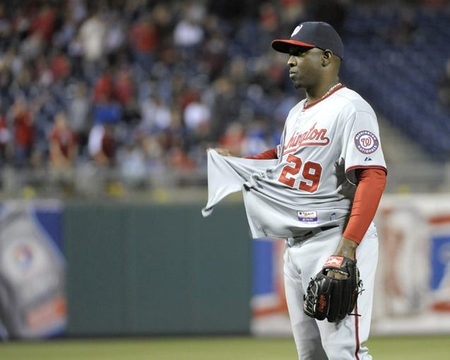 May 2, 2014; Philadelphia, PA, USA; Washington Nationals relief pitcher Rafael Soriano (29) untucks his jersey after getting the final out against the Philadelphia Phillies at Citizens Bank Park. The Nationals defeated the Phillies, 5-3. Mandatory Credit: Eric Hartline-USA TODAY Sports
