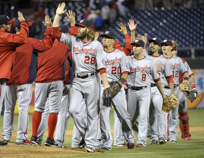 May 2, 2014; Philadelphia, PA, USA; Washington Nationals right fielder Jayson Werth (28), shortstop Ian Desmond (20) and second baseman Danny Espinosa (8) celebrate win against the Philadelphia Phillies at Citizens Bank Park. The Nationals defeated the Phillies, 5-3. Mandatory Credit: Eric Hartline-USA TODAY Sports