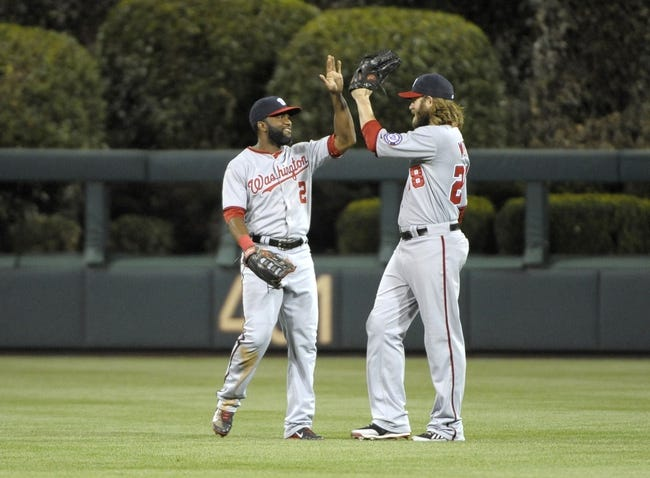 May 2, 2014; Philadelphia, PA, USA; Washington Nationals center fielder Denard Span (2) and right fielder Jayson Werth (28) celebrate win against the Philadelphia Phillies at Citizens Bank Park. The Nationals defeated the Phillies, 5-3. Mandatory Credit: Eric Hartline-USA TODAY Sports