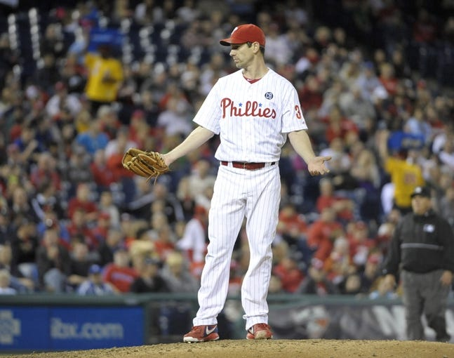 May 2, 2014; Philadelphia, PA, USA; Philadelphia Phillies starting pitcher Cliff Lee (33) gestures towards  Washington Nationals center fielder Denard Span (2) (not pictured) after he threw an inside pitch to him during the fifth inning at Citizens Bank Park. The Nationals defeated the Phillies, 5-3. Mandatory Credit: Eric Hartline-USA TODAY Sports