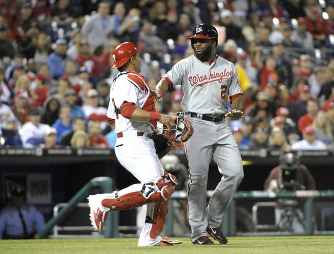 May 2, 2014; Philadelphia, PA, USA; Philadelphia Phillies catcher Carlos Ruiz (51) tries to stop Washington Nationals center fielder Denard Span (2) from going out to the pitchers mound in the 5th inning at Citizens Bank Park. The Nationals defeated the Phillies, 5-3. Mandatory Credit: Eric Hartline-USA TODAY Sports