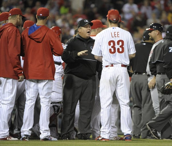 May 2, 2014; Philadelphia, PA, USA; Umpire Fieldin Culbreth (25) talks to Philadelphia Phillies starting pitcher Cliff Lee (33) after threw a pitch inside to Washington Nationals center fielder Denard Span (2) (not pictured) at Citizens Bank Park. The Nationals defeated the Phillies, 5-3. Mandatory Credit: Eric Hartline-USA TODAY Sports